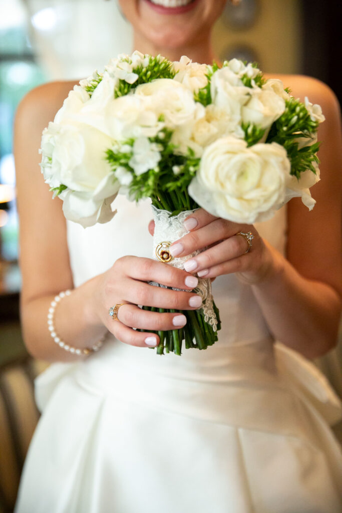 Bride holding a white floral bouquet