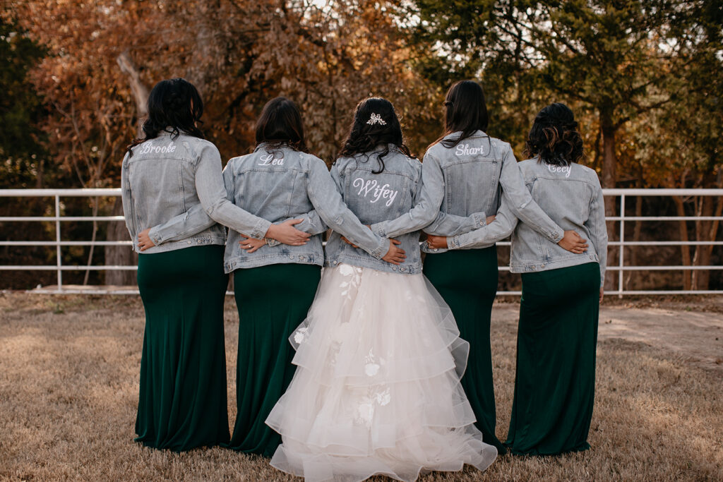 Brides and Bridesmaids wearing trendy wedding jackets