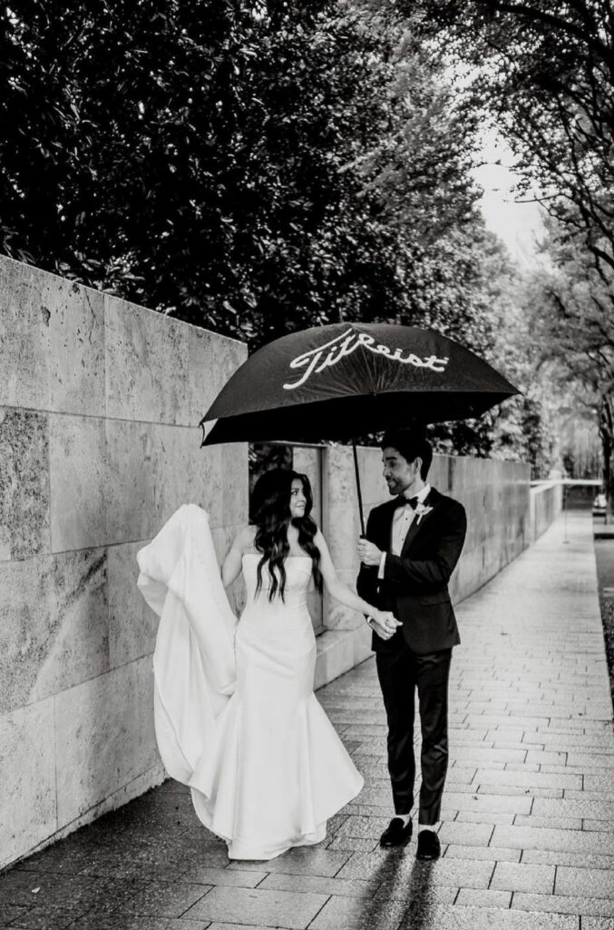 Real Bride Jessenia and Aaron holding an umbrella