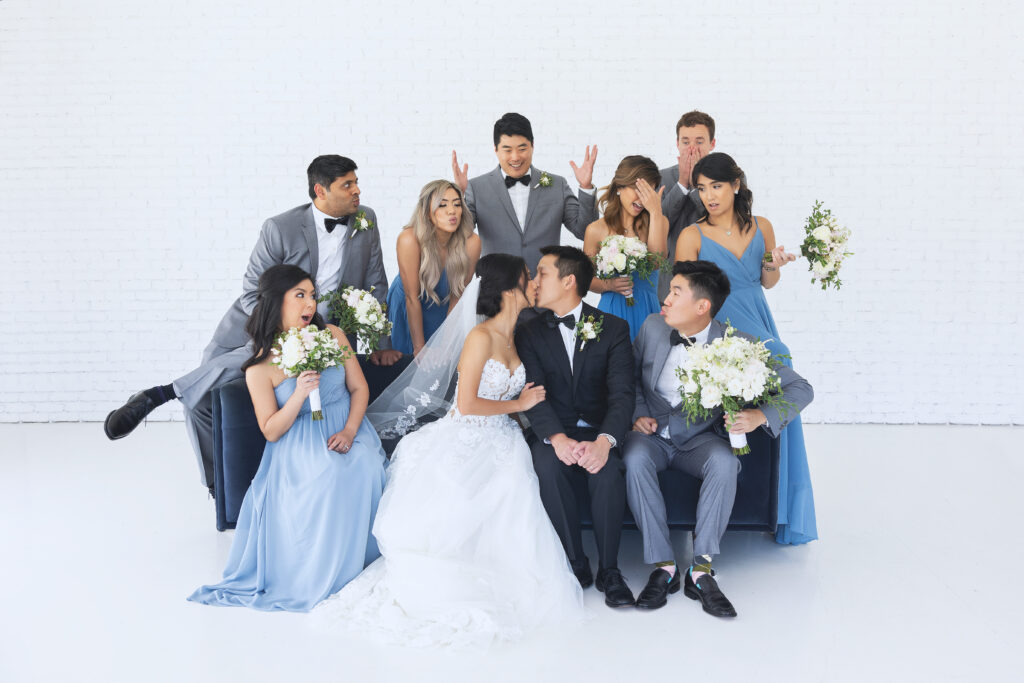 A bridal party taking a picture.